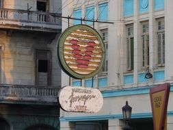 retro street sign at hotel on facade, cuba, havana