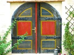 bright painted wooden door of old house