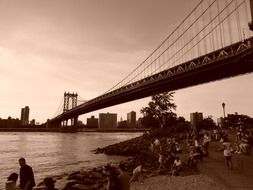 black and white image of the sunset over the Brooklyn Bridge, New York city