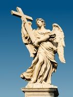 angel with cross at sky, sculpture on sant\'angelo bridge, italy, rome
