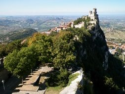 Rocca or Guaita fortress tower on mountain above countryside, san marino