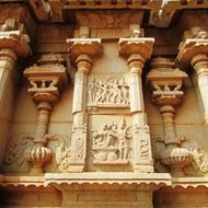 ancient stone carving on wall of hindu temple, india, hampi