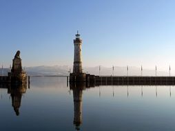 lighthouse with clock and Bavarian Lion sculpture on lake constance, germany, lindau