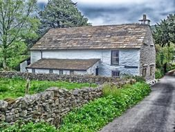 old stone village building at road, uk, england, sedbergh