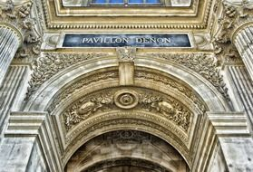 ornate entrance to louvre palace, france, paris