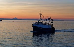 fishing boat at the sunset in harbor