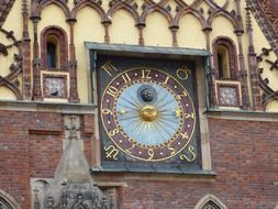 antique clock on town hall, poland, wroclaw
