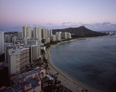 modern city on coast at dusk, usa, hawaii, honolulu, waikiki beach