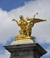 golden statue on Pont Alexandre III Bridge over the River Seine at sky, france, paris