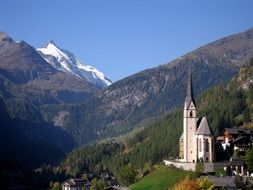 Holy Blood church and the snow-capped Grossglockner in the high tauern mountain range, Austria, Carinthia
