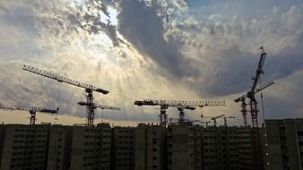 Aerial view on the building construction and cranes on a background of clouds