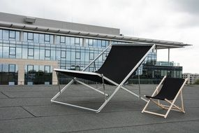 two beach chairs on roof, poland, warsaw