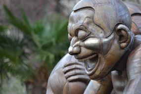 laughing man face, sculpture