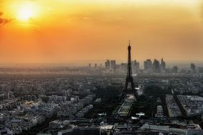 orange sunset sky above grey cityscape, france, paris