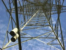 girders of electric tower at sky, bottom view