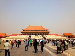 people on pavement at hall of supreme harmony in forbidden city, china, beijing