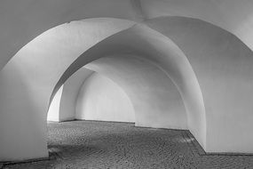 round arches in white stone walls