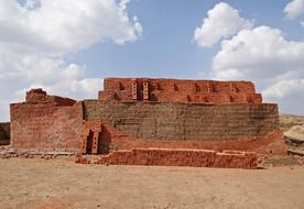 large pile of red and brown bricks on ground, india, dharwad