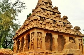 ancient monument with stone carved figures in Pancha Rathas complex, india, Mahabalipuram