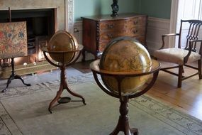 antique world globes in study room of georgian house