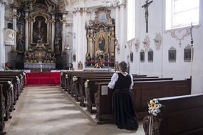 praying woman in baroque church, germany, berbling