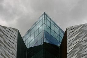 Angled glass facade of modern building