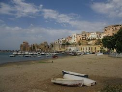 boats on beach at harbour town, italy, sicily