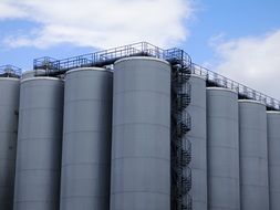 industrial fermentation tanks at sky