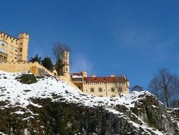 hohenschwangau castle on mountain at winter, germany, füssen