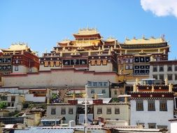 colorful traditional buildings of tibetian buddhist Ganden Sumtsenling Monastery, china