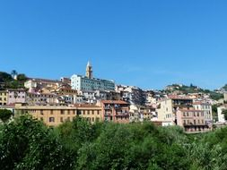distant view of santa maria assunta cathedral in old town, italy, ventimiglia