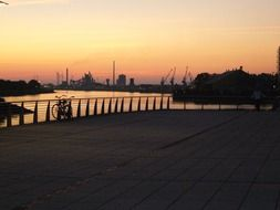 sunset afterglow in sky above harbour, germany, bremen
