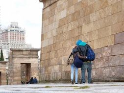 back view of young couple in love on street, spain, madrid