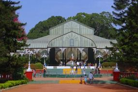 fountain in front of greenhouse in beautiful park, india, bangalore, Lal Bagh Botanical Garden