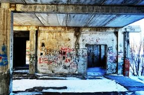vandalism, grunge graffiti on walls of ruined abandoned building