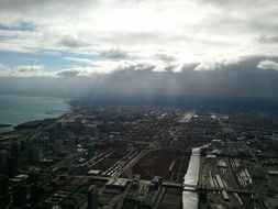 aerial view of city under stormy clouds, usa, illinois, chicago