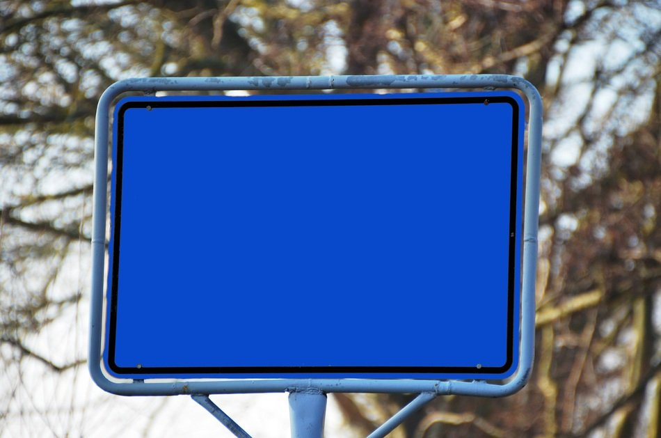 town blue sign board road