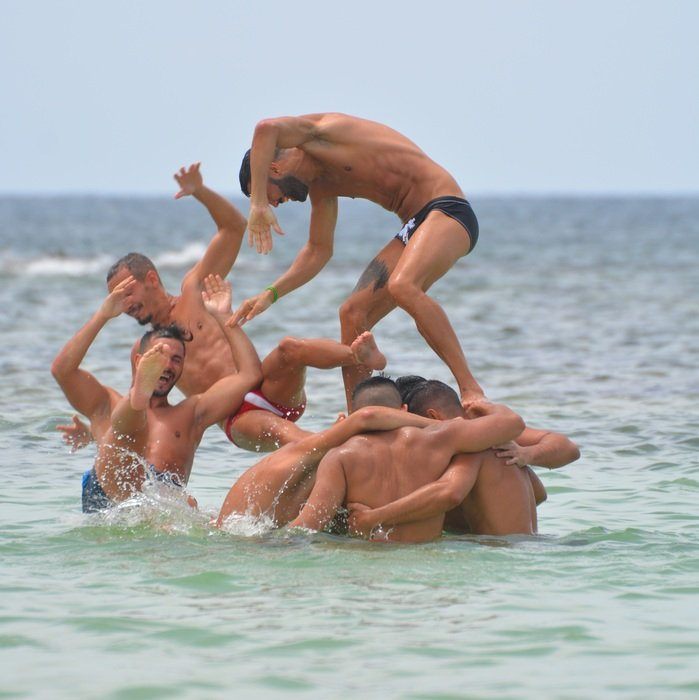 men having fun in the sea
