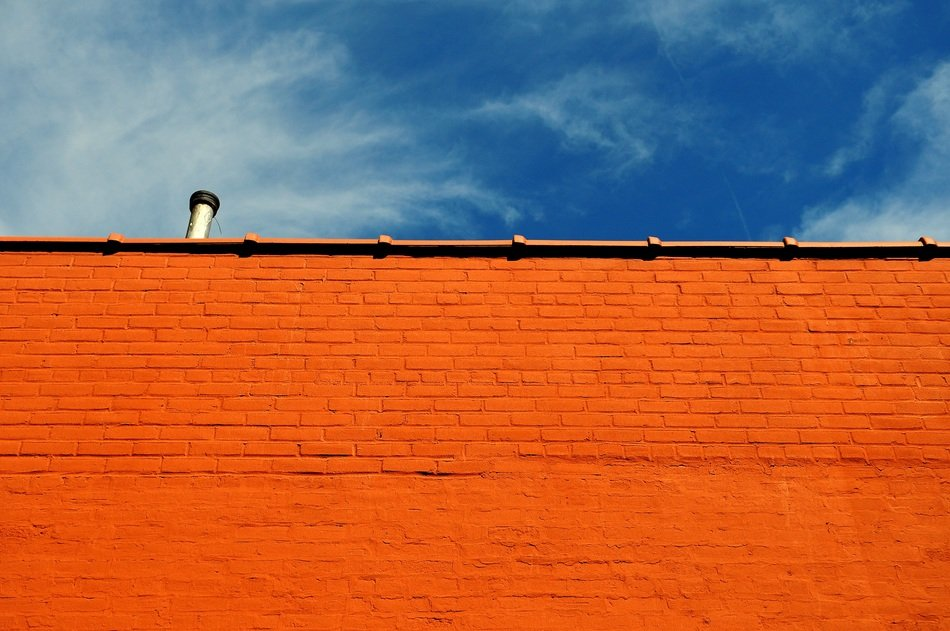 red brick wall at blue sky
