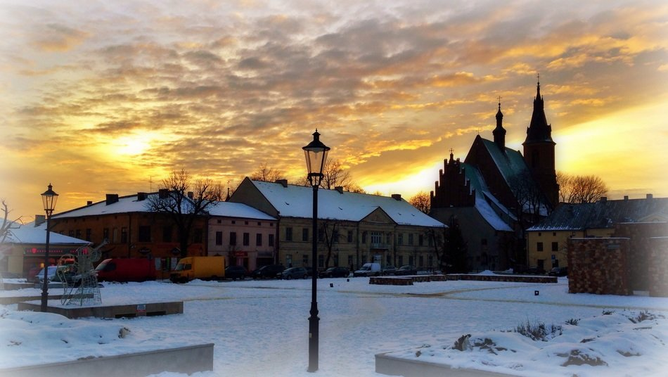cloudy sky above old city at sunset, poland, olkusz