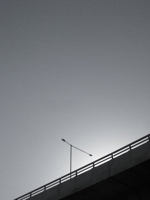 lamp post on overpass at sky, black and white