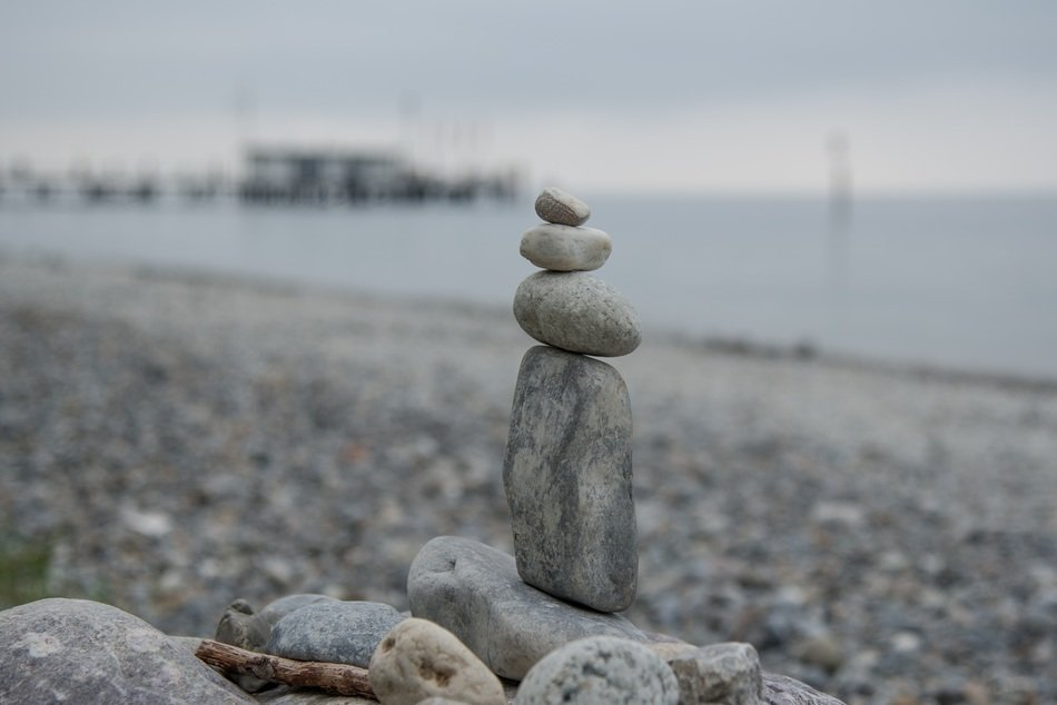 stones sculpture statue fig beach sea