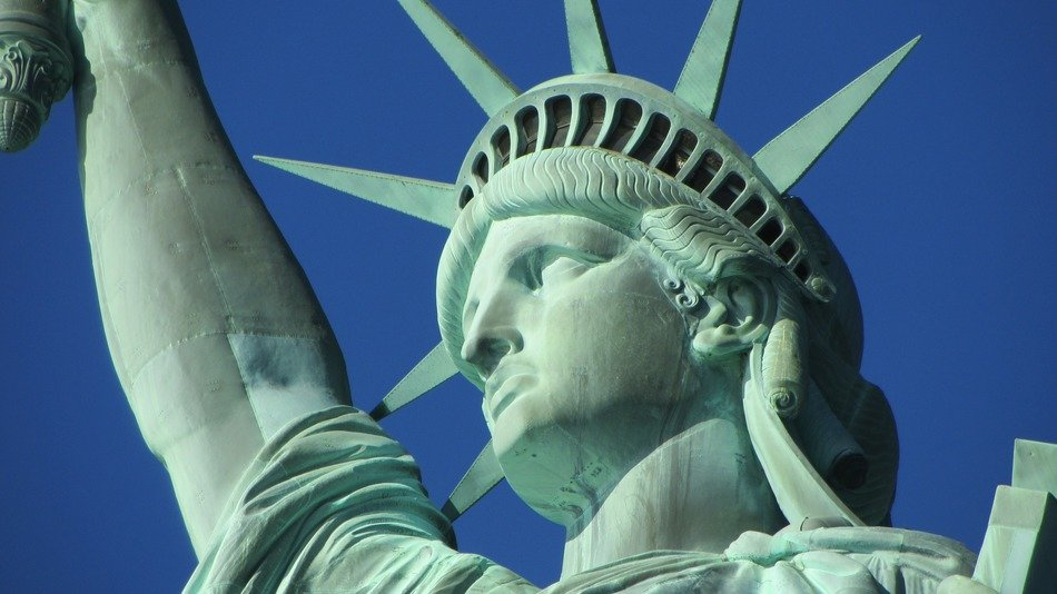 statue of liberty face at sky close up, usa, new york city