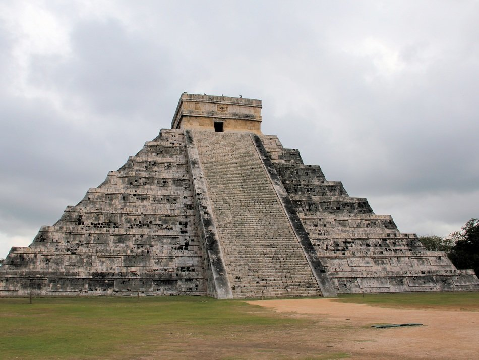 maya Temple of Kukulcan at cloudy sky, mexico, chichén itzá