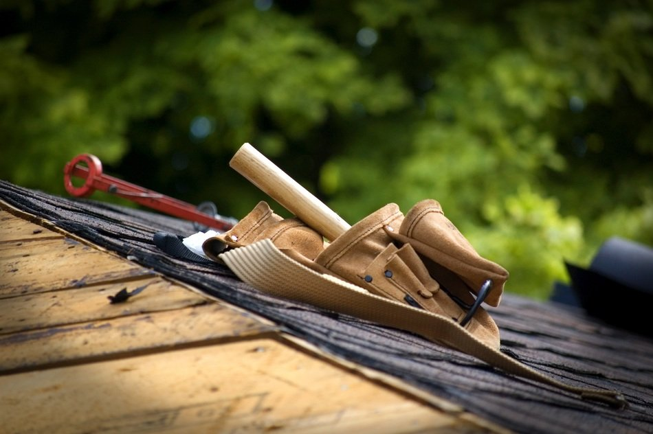 carpenter tools in belt on roof