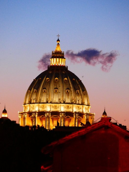 illuminated dome of st peter's basilica at evening sky, italy, rome, vatican