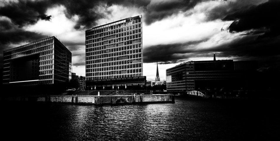 office buildings at water under dramatic clouds, germany, hamburg