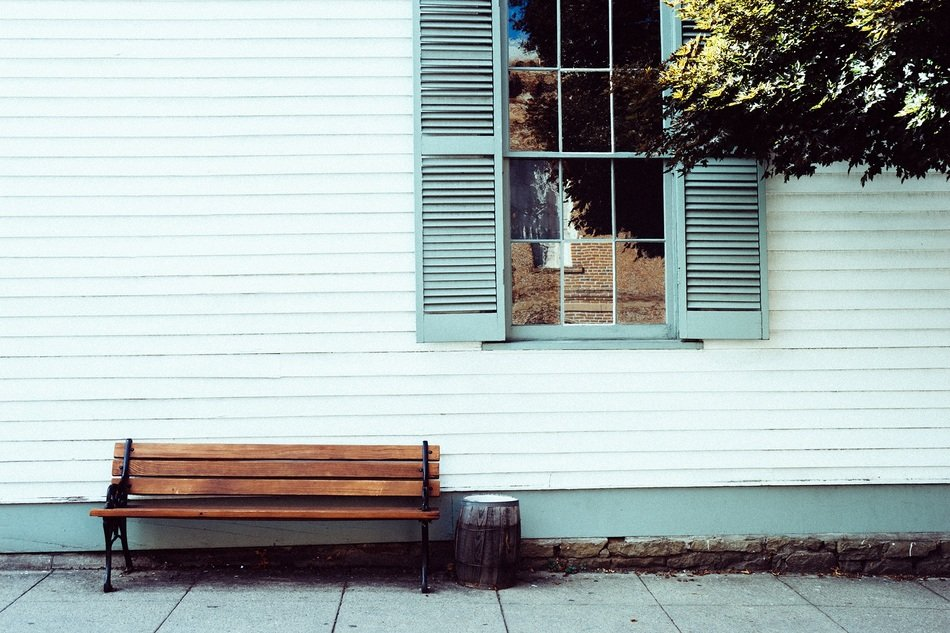 wooden bench in front of house