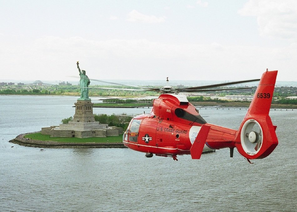 red helicopter in sky at statue of liberty, usa, new york city