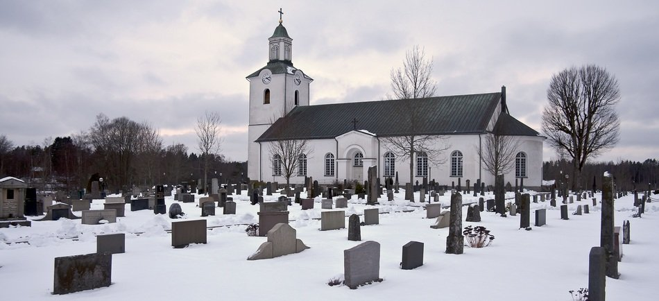 graveyard in front of church at winter